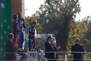 Lando Norris, McLaren, 2nd position, Daniel Ricciardo, McLaren, 1st position, and Valtteri Bottas, Mercedes, 3rd position, on the podium