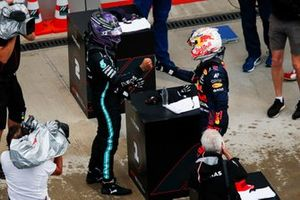Lewis Hamilton, Mercedes, 1st position, and Max Verstappen, Red Bull Racing, 2nd position, congratulate each other in Parc Ferme