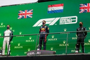 George Russell, Williams, 2nd position, Max Verstappen, Red Bull Racing, 1st position, and Lewis Hamilton, Mercedes, 3rd position, on the podium