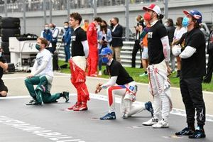 Sebastian Vettel, Aston Martin, Charles Leclerc, Ferrari, Mick Schumacher, Haas F1, Antonio Giovinazzi, Alfa Romeo Racing, and Fernando Alonso, Alpine F1, stand and kneel in support of the End Racism campaign prior to the start