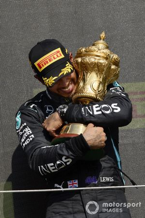 Lewis Hamilton, Mercedes, 1st position, with the original trophy on the podium