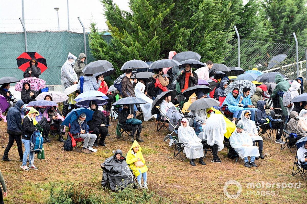 Fans watching race in the rain