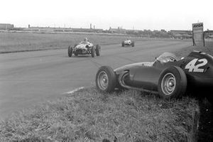 Roy Salvadori, Aston Martin DBR4/250, leads Chris Bristow, Cooper T51 Borgward, past the abandoned BRM P25 of Ron Flockhart