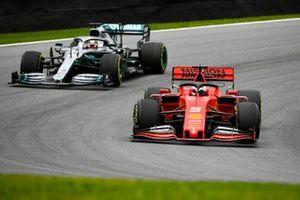 Sebastian Vettel, Ferrari SF90 and Lewis Hamilton, Mercedes AMG F1 W10