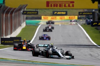 Valtteri Bottas, Mercedes AMG W10, leads Alexander Albon, Red Bull RB15