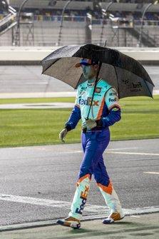 Denny Hamlin, Joe Gibbs Racing, Toyota Camry FedEx Express walks down pit road in the rain
