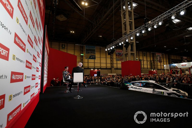 Presenter Alan Hyde interviews Lando Norris, McLaren on the Autosport stage in front of a large crowd