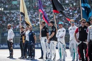 The drivers line up on the grid