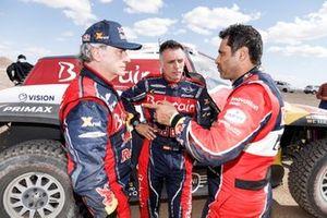 #305 JCW X-Raid Team: Carlos Sainz, Lucas Cruz, #300 Toyota Gazoo Racing: Nasser Al-Attiyah