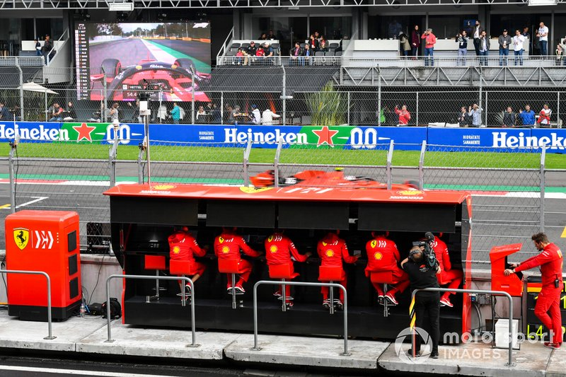 Charles Leclerc, Ferrari SF90, passes the Ferrari team on the pit wall