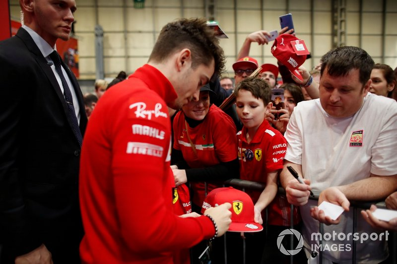 Charles Leclerc, Ferrari signs autographs for fans in front of the Autosport stage