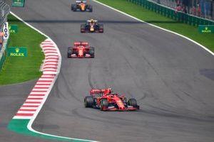Charles Leclerc, Ferrari SF90, leads Sebastian Vettel, Ferrari SF90, and Alexander Albon, Red Bull RB15