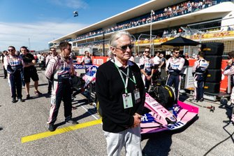 Michael Douglas in front of the Lance Stroll Racing Point RP19 on the grid