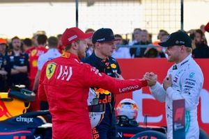 Top 3 Qualifiers Sebastian Vettel, Ferrari, Max Verstappen, Red Bull Racing, and pole man Valtteri Bottas, Mercedes AMG F1, on the grid after Qualifying