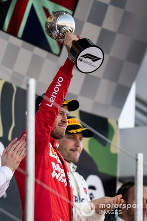 Sebastian Vettel, Ferrari, 2nd position, lifts his trophy