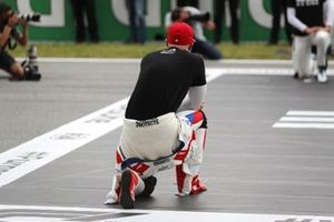 Nikita Mazepin, Haas F1, takes a knee on the grid