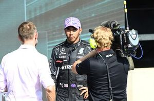Lewis Hamilton, Mercedes, 1st position, is interviewed by Jenson Button after the race