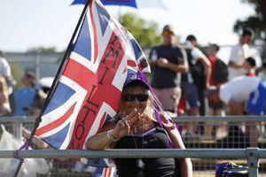 A Lewis Hamilton fan with a flag