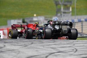 Valtteri Bottas, Mercedes W12, approaches as Carlos Sainz Jr., Ferrari SF21, spins