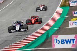 George Russell, Williams FW43B, Carlos Sainz Jr., Ferrari SF21, and Kimi Raikkonen, Alfa Romeo Racing C41