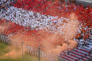 Fans form the Austrian flag in a grandstand