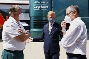 Oliver Dowden CBE, Secretary of State for Digital, Culture, Media and Sport, talks with Otmar Szafnauer, Team Principal and CEO, Aston Martin F1, and Stefano Domenicali, CEO, Formula 1