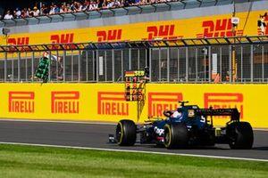 Sebastian Vettel, Aston Martin AMR21, passes his pit board