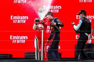 Arthur Leclerc, Prema Racing, 1st position, sprays the victory Champagne on the podium