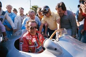 Niki Lauda takes a seat in a Mercedes Grand Prix car from 1954 with next to him Juan Manuel Fangio