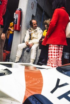 Denny Hulme sits on the pit wall