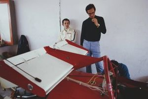 Jacky Ickx and Mauro Forghieri with Ickx's Ferrari 312B in the garage