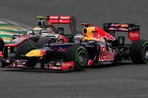 Sebastian Vettel, Red Bull RB8 Renault, battles with Lewis Hamilton, McLaren MP4-27 Mercedes