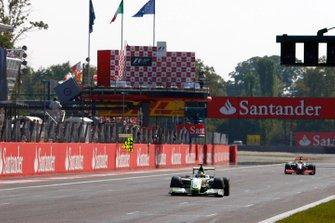 Jenson Button, Brawn GP BGP001 Mercedes, Lewis Hamilton, McLaren MP4-24 Mercedes