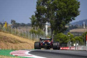 Sparks kick up from the rear of Alex Albon, Red Bull Racing RB16