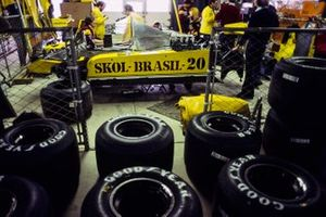 Goodyear tyres stacked near to Emerson Fittipaldi's Fittipaldi F8 Ford in the garage