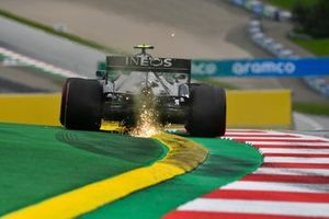 Sparks fly from the rear of Valtteri Bottas, Mercedes F1 W11