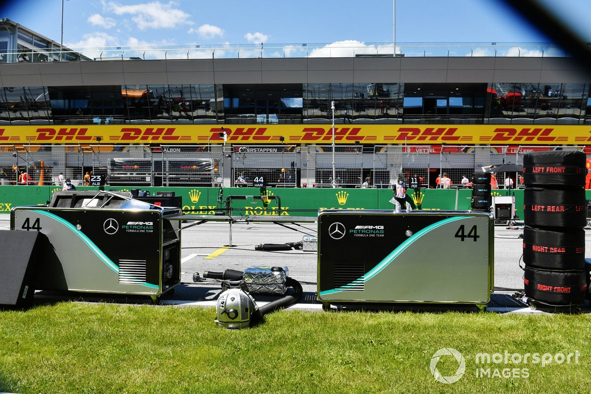 The Mercedes team prepare on the grid