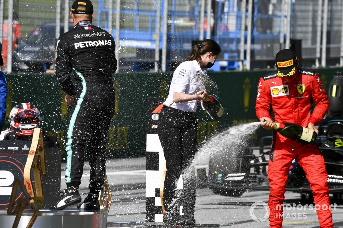 Charles Leclerc, Ferrari and Race winner Valtteri Bottas, Mercedes-AMG Petronas F1 celebrate on the podium with the champagne