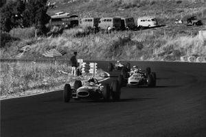 Jo Siffert, Brabham-BRM, leads Innes Ireland, BRP-BRM