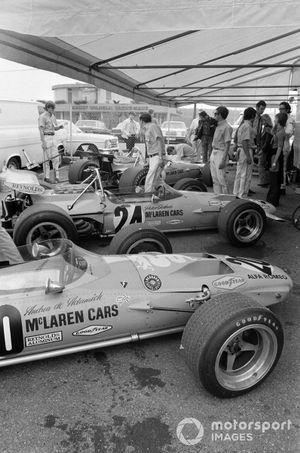 Andrea de Adamich's McLaren M14D Alfa Romeo and Peter Gethin's McLaren M14A Ford in the paddock