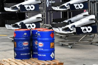 Esso oil drums in front of spare AlphaTauri noses and front wings