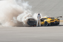 Marcel Fässler with a fire extinguisher at the #4 Corvette Racing Chevrolet Corvette C7.R on fire
