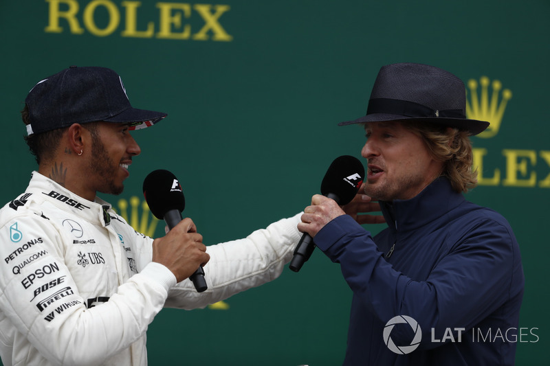 Actor Wilson interviews Race winner Lewis Hamilton, Mercedes AMG F1, on the podium