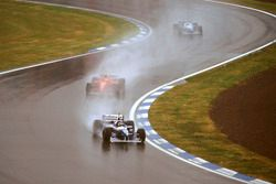 Jacques Villeneuve, Williams FW18 Renault with Michael Schumacher, Ferrari F310 and Jean Alesi, Bene