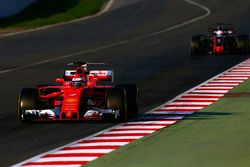 Kimi Raikkonen, Ferrari SF70H, leads Romain Grosjean, Haas F1 Team VF-17