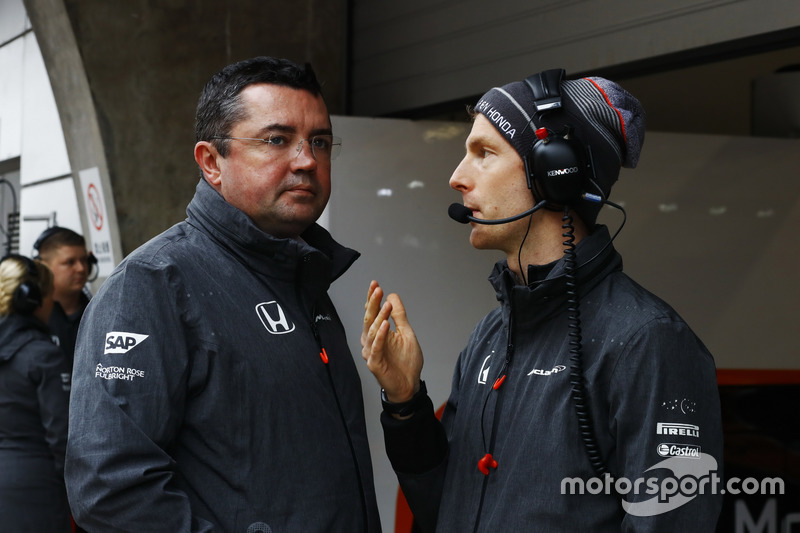 Eric Boullier, Racing Director, McLaren, waits with a colleague during a weather delay in FP2