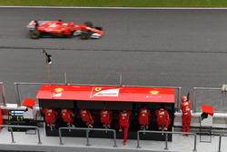 Sebastian Vettel, Ferrari SF70H passes the Ferrari pit wall gantry