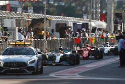 The safety car lines-up in the pit lane ahead of Lewis Hamilton, Mercedes AMG F1 W08