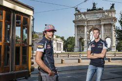 Carlos Sainz Jr. and Daniil Kvyat pose for a portrait in front of Arco della Pace