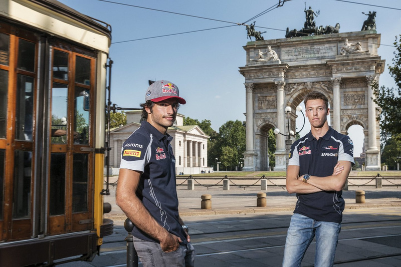 Carlos Sainz Jr. and Daniil Kvjat pose for a portrait in front of Arco della Pace